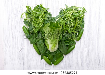 Green vegetables in heart shape on a background - stock photo