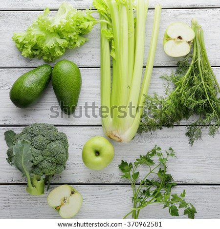 green vegetables on white boards, food top view - stock photo