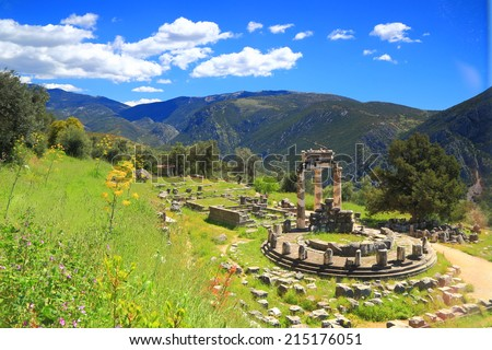 Green vegetation on Parnassus Mountains surrounding a temple dedicated to Greek goddess Athena, Delphi, Greece - stock photo