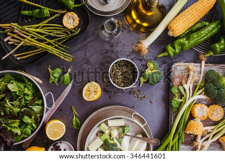 Green veggies and fruit tabletop with superfoods. Abstract green food background. rustic dark style. top view.  - stock photo