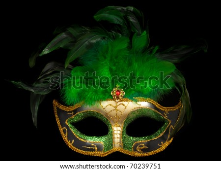Green Venetian theater mask isolated on black - stock photo