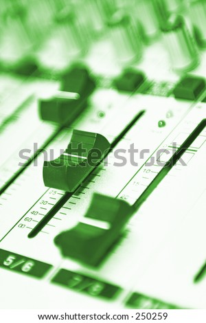 Green Video Mixing Desk Buttons, LED's and switches  - stock photo