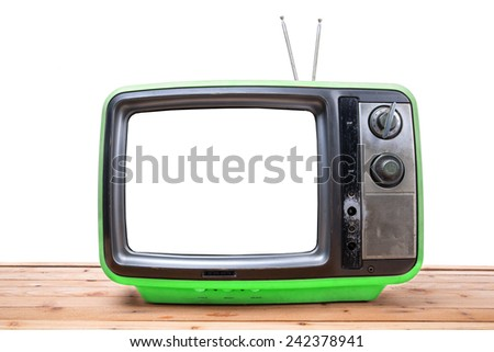 Green Vintage TV on wood table , isolated white background