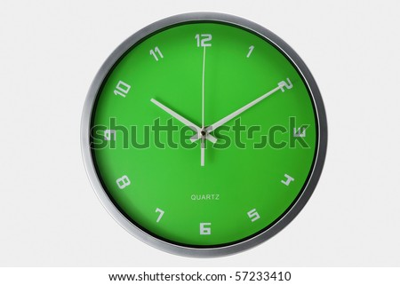 Green wall clock isolated with clipping path - stock photo