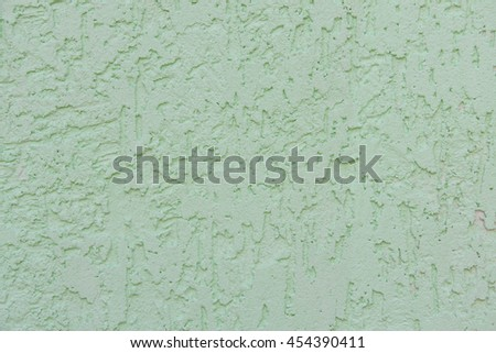 green wall with decorative plaster as a background - stock photo