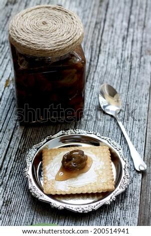 Green walnut jam - stock photo