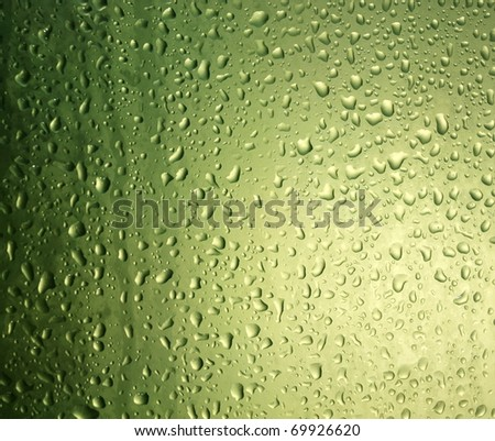 green water drops on glass - stock photo