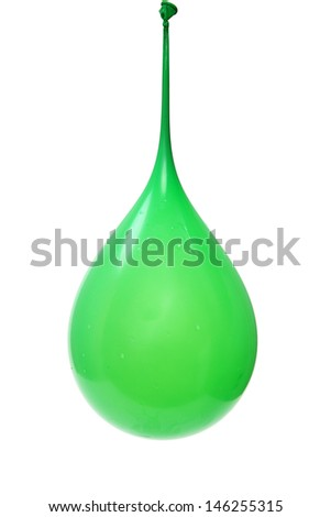 Green water filled balloon hanging suspended over white. - stock photo