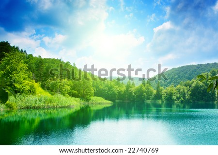 green water lake in forest - stock photo