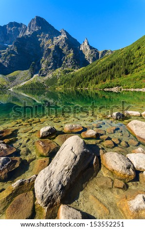 Green water mountain lake Morskie Oko, Tatra Mountains, Poland - stock photo
