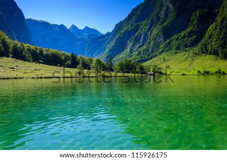 Green water of Konigsee mountain lake, Bayern, Germany - stock photo