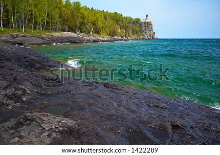 Green water under Split Rock Light House on Lake Superior North Shore. More with keyword Series14. - stock photo