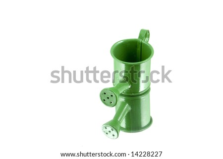 green watering can - stock photo