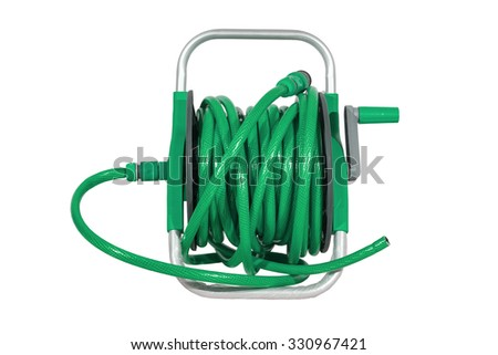 green watering garden hose on the spool isolated on white background. - stock photo