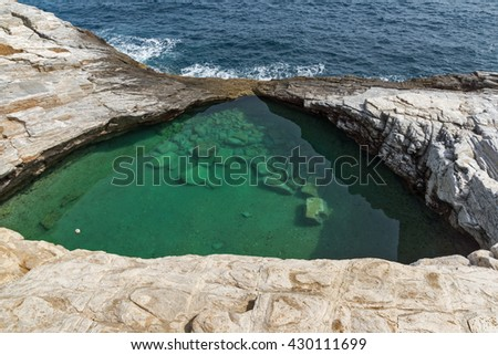 Green waters of Giola Natural Pool in Thassos island, East Macedonia and Thrace, Greece  - stock photo