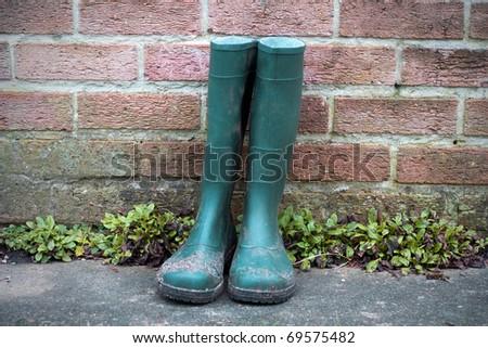 Green wellington boots. - stock photo