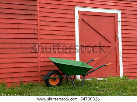 green wheelbarrow, red barn - simple farm scene