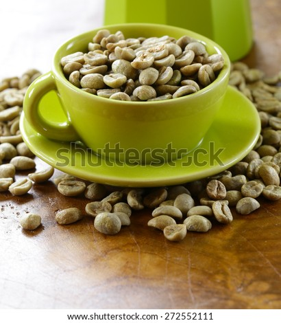 green (white) coffee beans on wooden background - stock photo