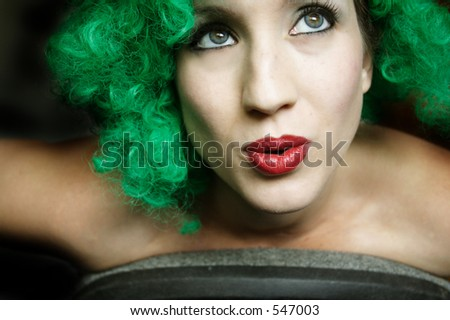Green Wig Woman-Great for Halloween, St. Patrick's Day, or just anything punk. - stock photo