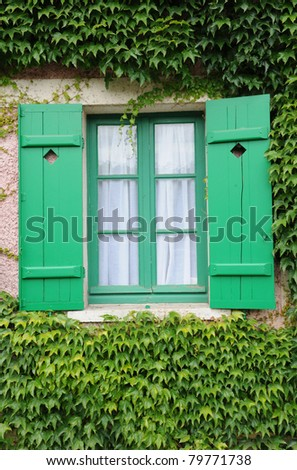 green window of an old house