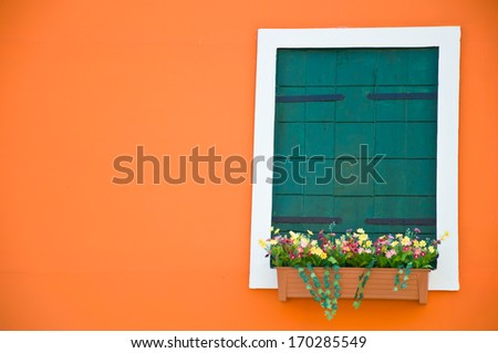green  window on orange wall