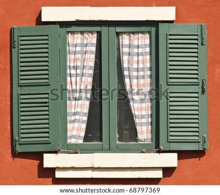 Green window with brown wall - stock photo