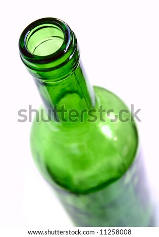 Green wine bottle on side with white background