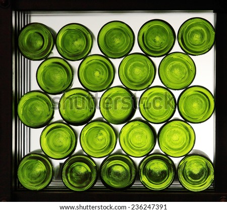 Green wine bottles against on shelf - stock photo