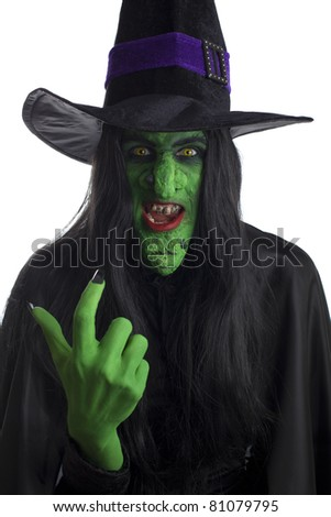 Green witch beckoning you over, white background. - stock photo