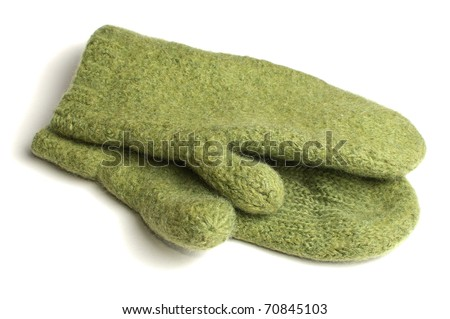 Green wollen knitted mittens over white background - stock photo