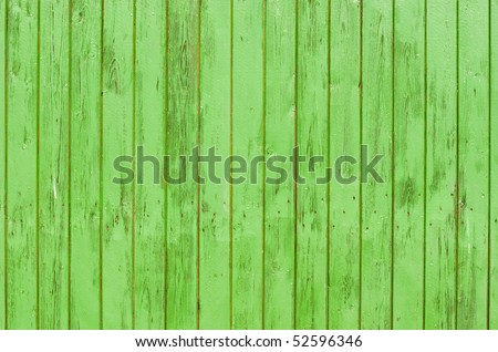 Green wood background. Close-up view of old wood wall colored in green. - stock photo
