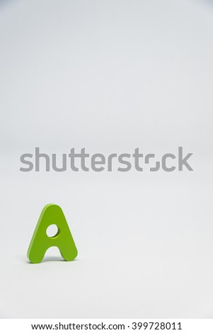 Green Wooden alphabet A with white background in Vertical view - stock photo
