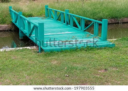 Green Wooden Bridge - stock photo