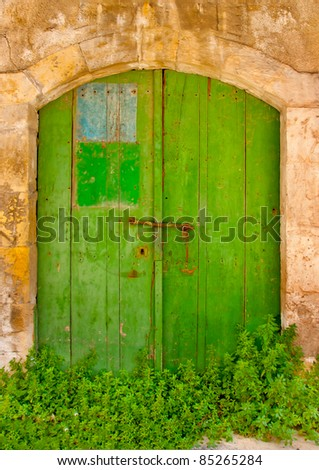 Green wooden door of an old store in Limassol Cyprus - stock photo