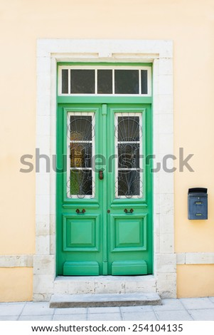 Green wooden door. Traditional architecture - stock photo