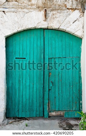 green wooden gates - stock photo