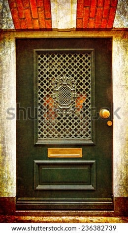 Green wooden glass door of a brick classical building, Europe. Architectural theme. Photo in retro style. Paper texture. Aged textured photo in retro style  - stock photo