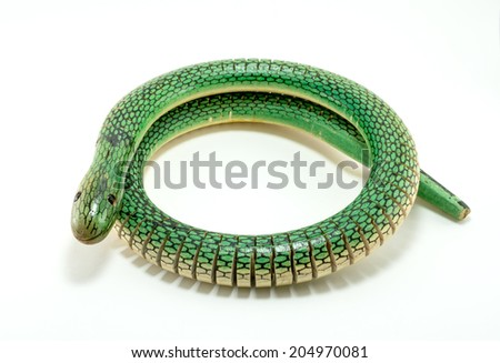green wooden snake toy for kids play
