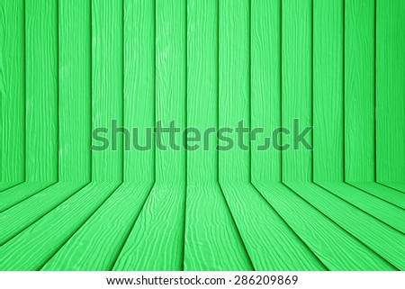 Green wooden wall and wooden floor background.