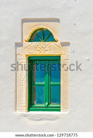 Green wooden window of a church in Hozoviotissa monastery in Amorgos island in Greece - stock photo