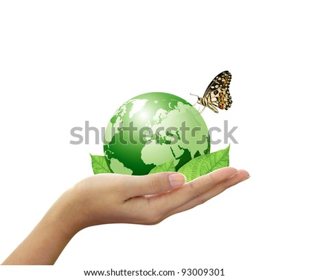 Green world and leaf have butterfly in woman hand - stock photo