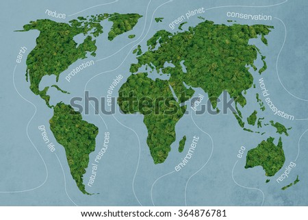 Green world. Close-up image of moss textured world map at the blue background - stock photo