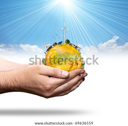 Green world concept with aerogenerator and solar panel - stock photo