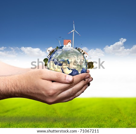 Green world concept with windmill and solar panel. More in my portfolio - stock photo