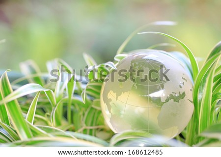 green world in grass background  - stock photo