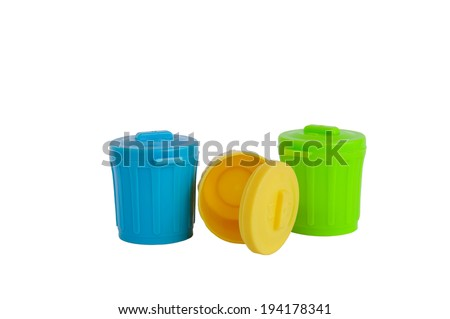 Green, yellow and blue plastic trash cans isolated on white - stock photo