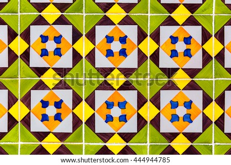 green, yellow and brown colored azulejos - tiles from Lisbon, Portugal