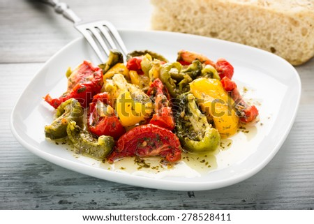 green, yellow and red semi dried tomatoes - stock photo