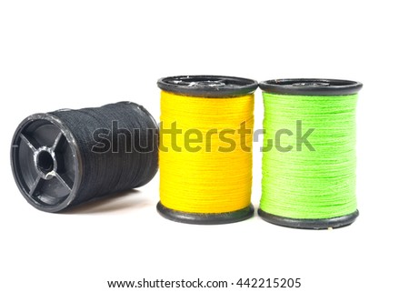 green,yellow,black thread isolated on white background