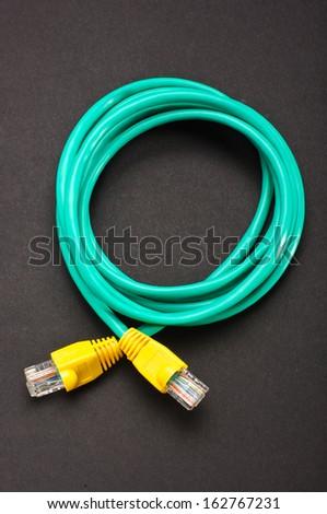 Green - yellow LAN cable - stock photo
